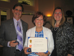 Photo: Susan Ann Weisman was presented with the Paul Harris Fellow award by District 6970  Governor Cynde Covington at the Rotary Club of DeBary-Deltona Annual Installation  and Awards Banquet held at the DeBary Golf and Country Club on June 5, 2010.  Looking on is Sher Weisman, Susan's husband.