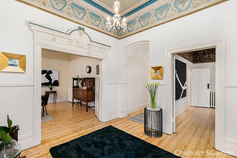 Original Tasmanian pine flooring and dramatic high ceilings with whimsical frieze