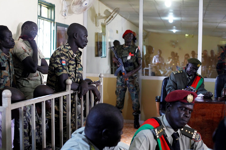 South Sudanese soldiers stand during their sentencing over the rape of foreign aid workers and the murder of a local journalist in an assault on the Terrain Hotel in the capital Juba in 2016, at a military court in Juba, South Sudan, September 6 2018. Picture: REUTERS