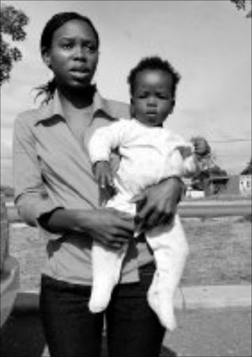 DESPERATE: Nombuso Ngubo with the eight-month-old baby boy she claims was dumped on her doorstep by his mother. Pic. Mhlaba Memela. 14/05/08. © Sowetan.