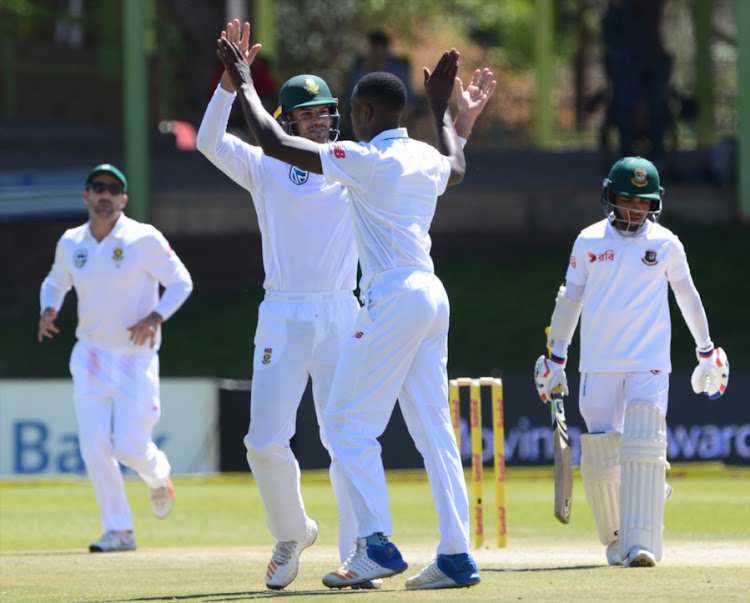 Aiden Markram and Kagiso Rabada of the Proteas celebrate the wicket of Mominul Haque of Bangladesh during day 3 of the 2nd Sunfoil Test match between South Africa and Bangladesh at Mangaung Oval on October 08, 2017 in Bloemfontein, South Africa.