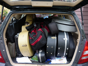 Photo: Two guitar players on their way to a duo gig. Overkill?