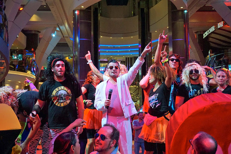One can't miss highlight on Symphony of the Seas is the Greatest '80s Party Ever in the Royal Promenade, where the cruise director dresses in white and the staff in '80s attire.