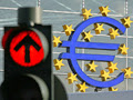 Photo: FRANKFURT, GERMANY - JUNE 13:  A huge euro logo is seen near Frankfurt Airport on June 13, 2005 in Frankfurt, Germany. The German economy was suffering due to the dollar's rise against most major currencies on Monday, especially the euro, which hit a new nine-month low against the dollar  (Photo by Ralph Orlowski/Getty Images)