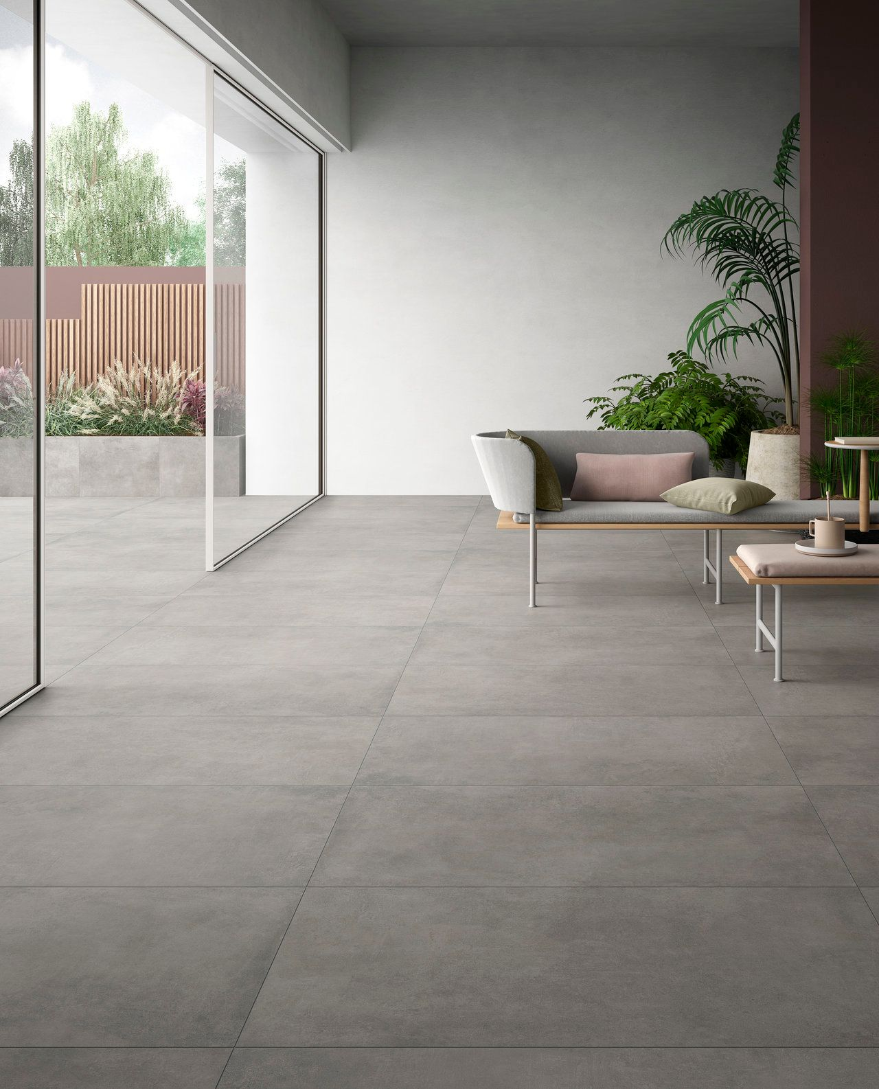 Concrete-look ceramic tile in an indoor-outdoor living room