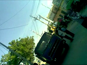 Photo: Police and traffic policeman taking illegal payment from truck driver.