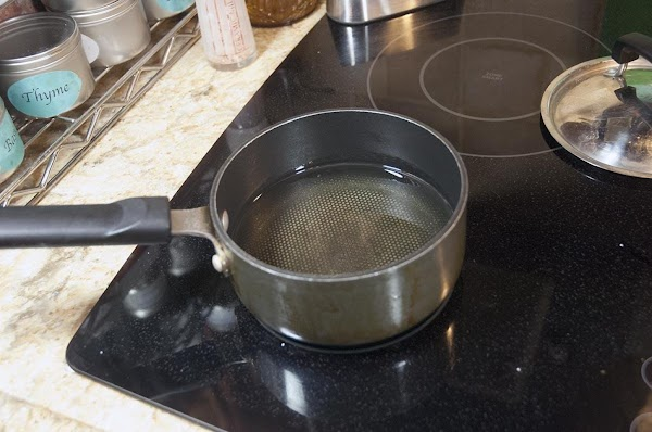 Heat about 3 inches (7.5cm) of peanut oil in a heavy-bottom pot to 350f...