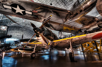 """Photo: It's been a while since I processed some images....but I'm back on track now!  This shot is from the National Air and Space Museum near Dulles Airport in Washington DC. The Enola Gay is lifted up on risers over several other """"smaller"""" airplanes completely dwarfing anything near it.  No tripods are allowed here so this was 3 shots handheld at 500 ISO plus lots of processing in Photomatix, Photoshop, Topaz and Color Efex."""