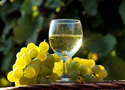 white wine and grapes outside