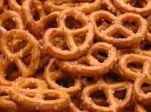 Open  both bags of pretzels and stir fast! Coating all pretzels, dump out...