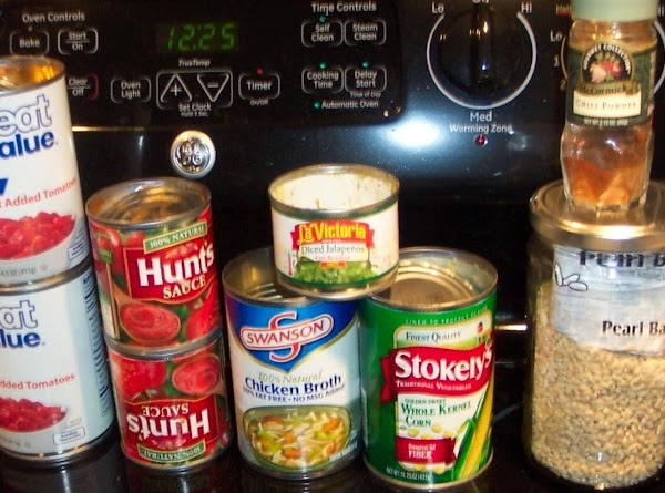 Add remaining ingredients, but not the chicken, or canned beans. Bring to a boil.Reduce heat to...