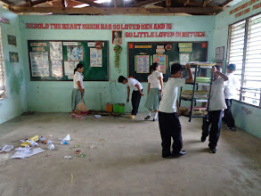 Photo: Kids removing items from classroom