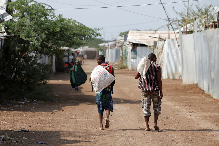 Men carry bags of food aid at the Kakuma refugee camp in Kenya on March 6 2018. File photo.