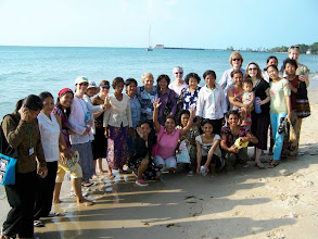 Photo: The team and Cambodian women at the beach (a first time experience for many of these women)