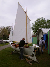 "Photo: Jim working on the rigging on his beautiful new peapod, ""Mouse"".  The sails are up for the first time but there's a lot of adjusting before the boat is ready to sail."