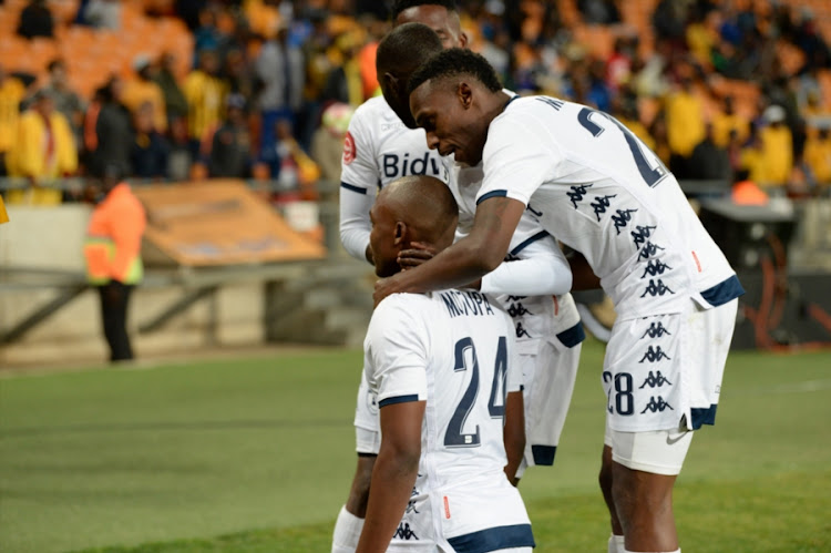 Bidvest Wits striker Gift Motupa celebrates with teammates Terrence Dzvukamanja and Thabang Monare after scoring a goal for his club during an Absa Premiership match against Kaizer Chiefs at FNB Stadium on August 07, 2018 in Johannesburg, South Africa. Wits won 3-1.