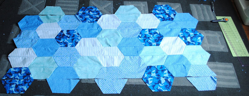 Photo: Sewing together the top half of the Catan quilt.  Lazy hexes may have a line through them, but they are soooo much nicer to sew then real hexes.