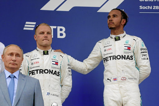 Lewis Hamilton (right) won the Sochi race in controversial style after his team-mate Valtteri Bottas (left) was forced to let him pass by Mercedes.