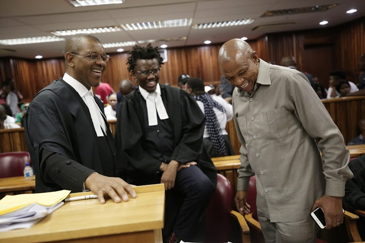 Supra Mahumapelo (right) shares a light-hearted moment with his legal team Advocate Dali Mpofu (left) and Advocate Tembeka Ngcukaitobi (centre) in between legal proceedings at the High Court in Johannesburg, where the ANC North West province are challenging the parties decision to disband it's Provincial Executive Committee.
