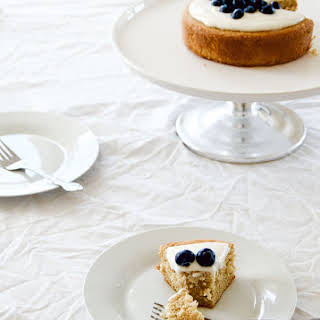 Hot Milk Cake with Blueberries and Tangy Greek Yogurt Icing.