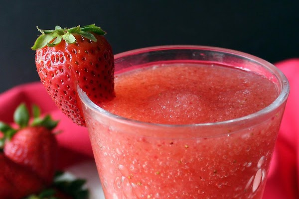 Garnish with a strawberry on the lip of glass or a mint leaf sprig.