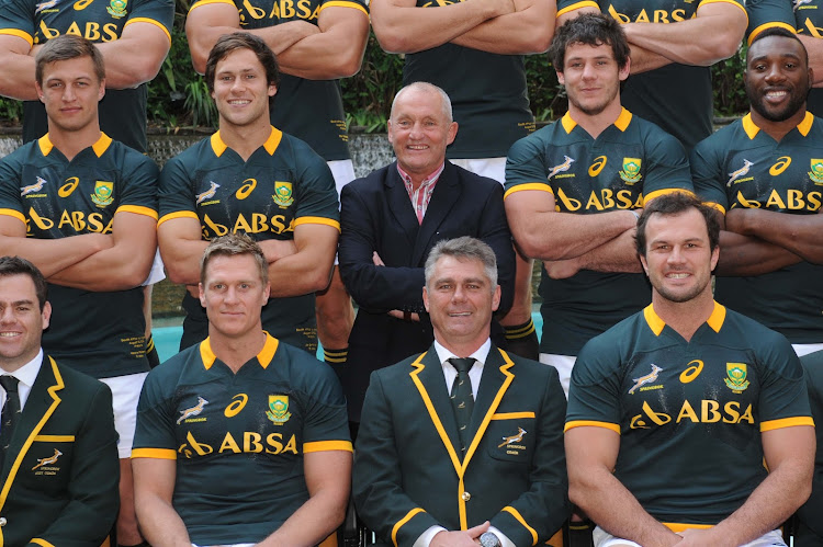 A file photo of John Robbie, who toured Aparthed South Africa with the British and Irish Lions in 1977, pose for a team picture with the Springboks in Tshwane in 2014.