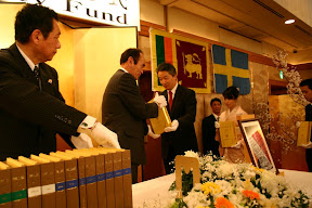 Japanese  Dhamma Society Patrons hand-carry Roman-script Tipitaka to be placed on high table, Osaka, 2007.