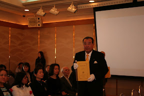 One of the leaders of business community carring Tipitaka in Roman-script into the ceremony hall, Osaka, 2007.