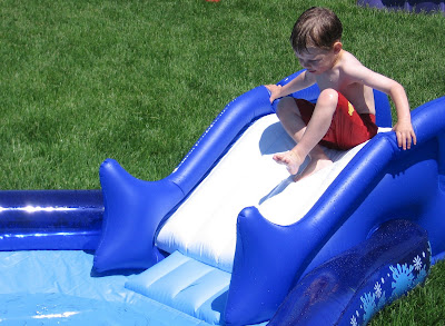 BigE sliding down the new inflatable pool