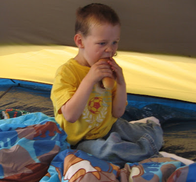 BigE having a hotdog in the tent