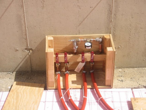 The manifold with PEX attached and 50 lbs of air in it.
