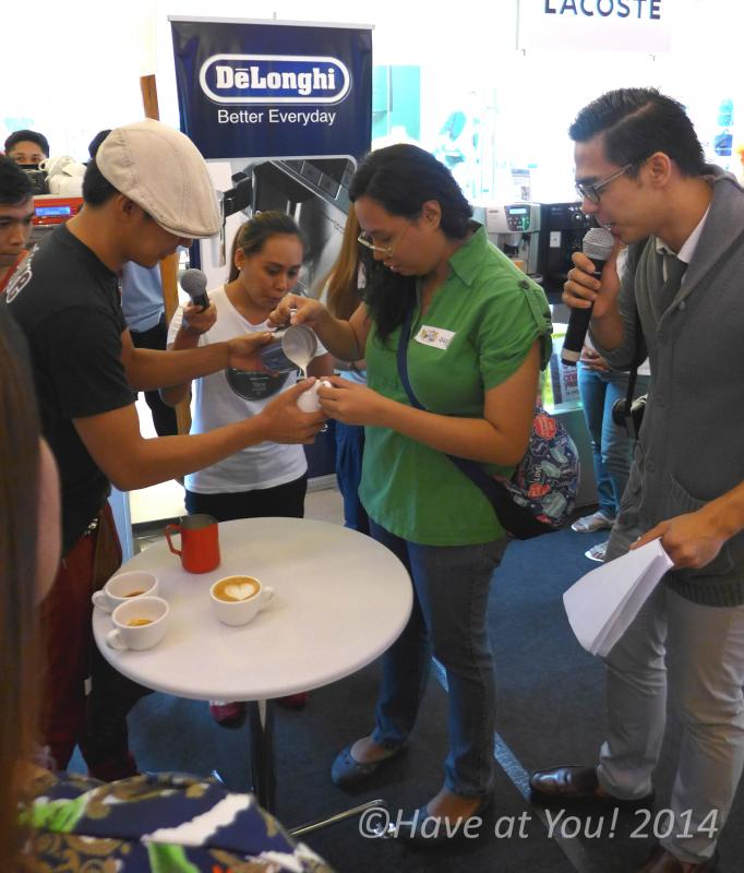Dems being assisted in making latte art