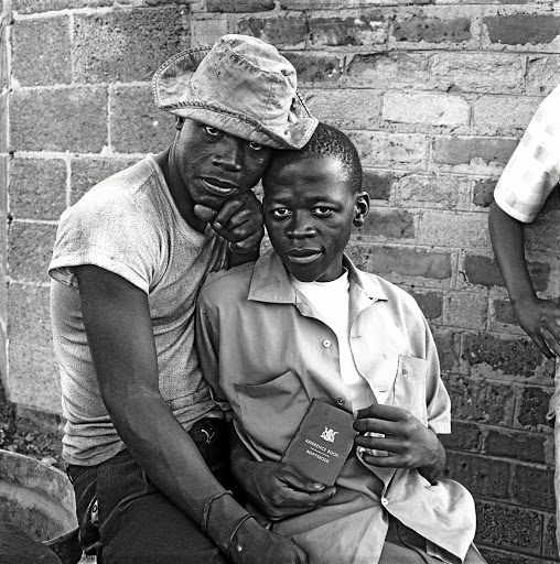 Witnesses: Young men with dompas in White City, Soweto, in a digital print on gelatin silver paper. Picture: DAVID GOLDBLATT AND GOODMAN GALLERY