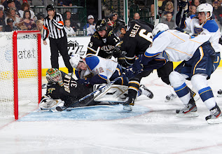 Photo: DALLAS, TX- APRIL 7: Richard Bachman #31 of the Dallas Stars makes a save against a diving attempt from David Backes #42 of the St. Louis Blues at the American Airlines Center on April 7, 2012 in Dallas, Texas. (Photo by Glenn James/NHLI via Getty Images)