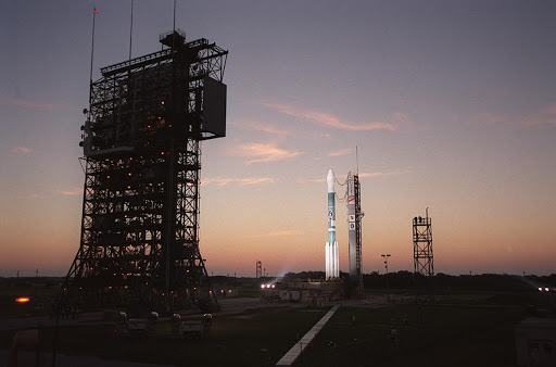 Dawn casts a pink glow as the Boeing Delta II rocket stands ready for launch after tower rollback.
