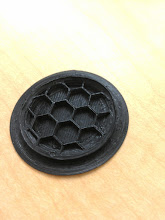 Photo: Failed part with 10% hexagonal infill. I set the Z stop juuuust too low, so it squished the layers and dragged a bit.
