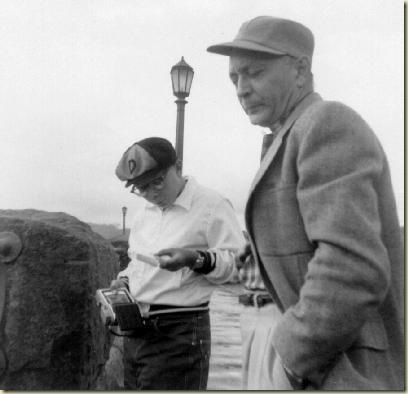 John (perusing Polaroid photo) and Charles Flora at Niagara Falls around 1956.
