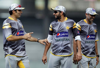 Photo: Pakistan's captain Misbah-ul-Haq (L) talks with teammate Shahid Afridi during a practice session ahead of their fourth One Day International cricket match against Sri Lanka in Colombo June 15, 2012. REUTERS/Dinuka Liyanawatte (SRI LANKA - Tags: SPORT CRICKET)