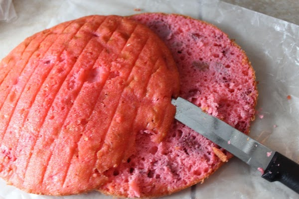 When cake has cooled, slice each layer in half making a total of 6...