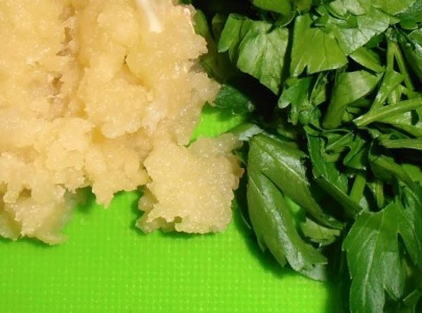 Chop parsley and with a microplane grate garlic