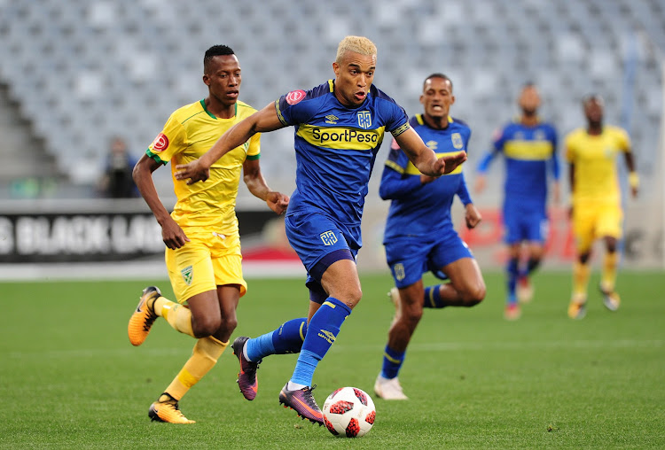 Matthew Rusike of Cape Town City pulls away from Divine Lunga of Lamontville Golden Arrows during the Absa Premiership match at Cape Town Stadium on August 18 2018.