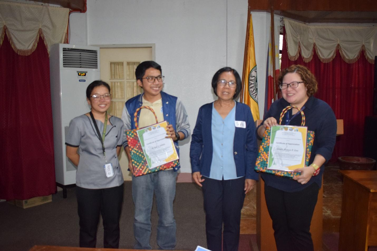 NEDA officers receiving their certificates and tokens from a seminar on the Rice Tarrification and Train Laws hosted by VSU's Young Economists' Society