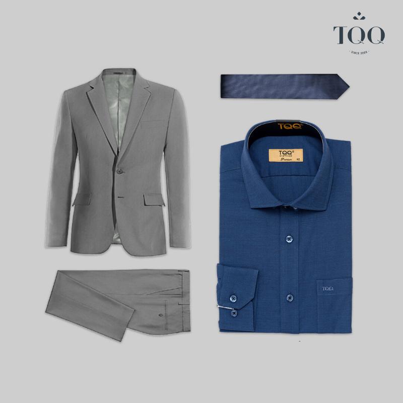 Kết hợp sơ mi nam màu xanh navy với bộ suit màu ghi xám để tạo sự nam tính, cuốn hút.