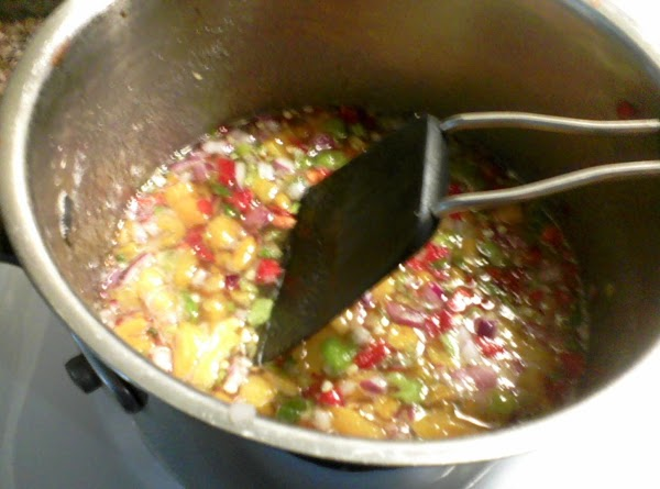 Add red onion, red pepper, and habenero peppers to apricots. Stir in sugar. CAUTION!!!! Use...