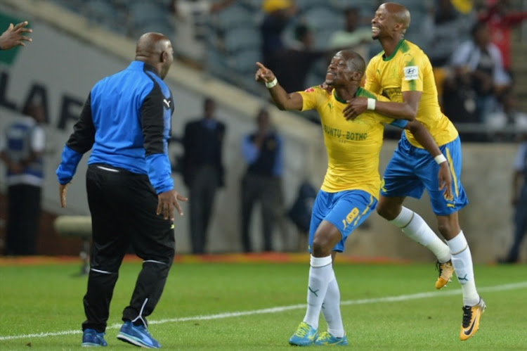 Pitso Mosimane (Coach), Hlompho Kekana and Tebogo Langerman of Mamelodi Sundowns celebrates a goal during the Absa Premiership match between Orlando Pirates and Mamelodi Sundowns at Orlando Stadium on November 01, 2017 in Johannesburg.