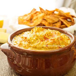 Creamy Spicy Hummus and Paprika Pita Chips.