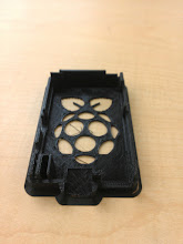 Photo: Fairly successfulperforated top for the Rich RapRaspberry Super-Pi case with mounting ears ( http://www.thingiverse.com/thing:25363 ) It was run on a cooler (55°C) bed and didn't bond as well as we've been seeing. Maybe we just need to tent the whole damn machine to get better temperature control?