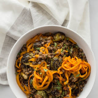 Balsamic Roasted Brussels Sprouts and Spiralized Butternut Squash with Lentils and Smashed Walnut Vinaigrette.