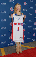 Photo: CLARKSTON, MI - AUGUST 12: Sheryl Crow poses with her Detroit Pistons jersey at the Palace Sports and Entertainment's Come Together Celebration concert at the DTE Energy Music Theater on August 12, 2012 in Clarkston, Michigan. (Photo by Paul Warner/Getty Images)