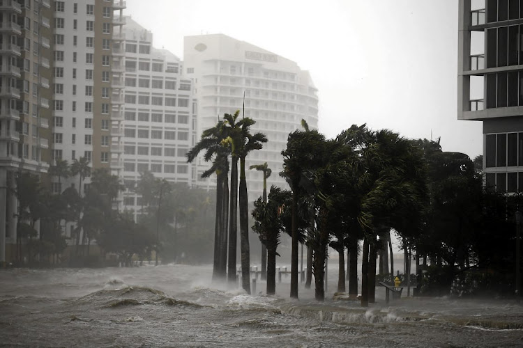 Battered streets in downtown Miami turn into raging rivers as Hurricane Irma, which weakened to a category three storm on Sunday, lashes the city.